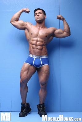 Rico Wolf in Muscle Puppy in Action at MuscleHunks
