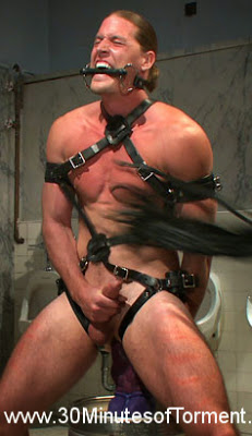 Straight hunk Kip Johnson endures three intense challenges before he's ordered to blow his load while riding a giant cock!