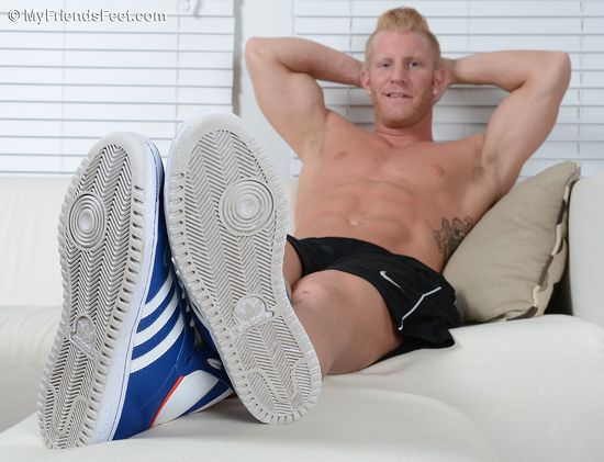 Johnny Shows Off His Dark Socks and Size 12 Feet